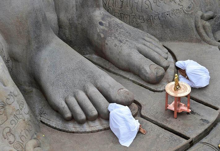 Doing pranam to the feet of Bahubali