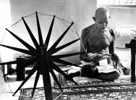 Gandhi with charkha